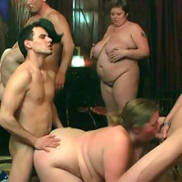 The orgy unfolds with the FAT GIRL on her hands and knees with a pecker inside her from both ends