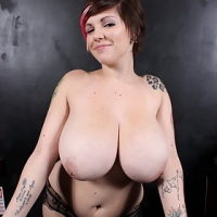Plumper Dors Feline gets her boobies out and plays DJ in a club