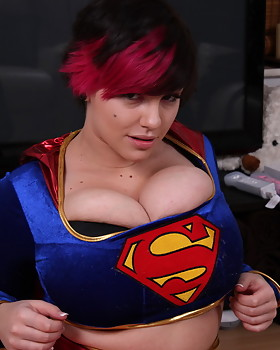 Big tit star Dors Feline squeezes her monstrous titties into her superwoman costume