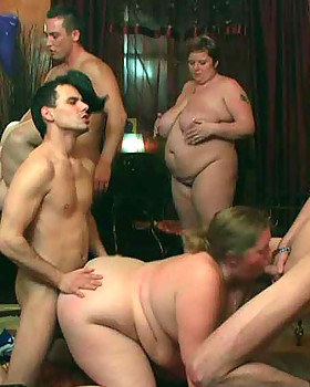 The orgy unfolds with the FAT GIRL on her hands & knees with a prick inside her from both ends