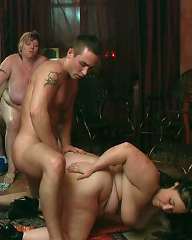 The BBW group scene features well-faired rolls of fat & a brunette on the floor taking prick deep